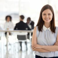 Millennial ambitious team leader, young employee, hr manager, female worker, intern girl smiling looking at camera, happy successful professional or business coach posing in modern office, portrait