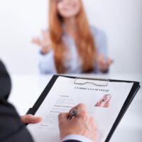 Close-up of young confident woman's job application