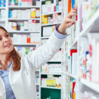 Photo_20of_20a_20professional_20pharmacist_20checking_20stock_20in_20an_20aisle_20of_20a_20local_20drugstore_202
